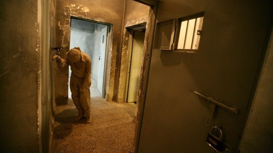 A dummy displayed in a cell at a former Iraqi torture centre that has been turned into a museum, on May 28, 2013. The concrete building lies in a wealthy neighbourhood of Sulaimaniyah, Iraqi Kurdistan's second city, 270 kilometres (170 miles) north of Baghdad.