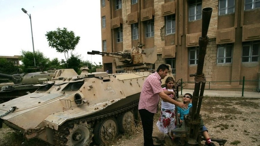 "A family visits a torture centre that was turned into a museum, on May 28, 2013, in the Iraqi Kurdish city of Sulaimaniyah. ""Interrogation"" at the Red House was a euphemism in Saddam's era for the barbaric means that the General Security Directorate used to extract ""confessions"" from inmates."