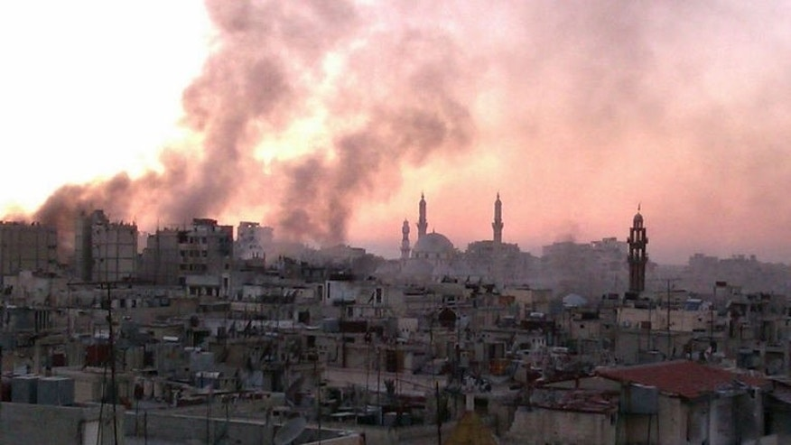 An image released by the Syrian opposition's Shaam News Network on July 9, 2013, allegedly shows smoke rising from buildings in Syria's central city of Homs following airstrikes by government forces. An army assault on Homs entered its 13th day on Thursday, as the Muslim fasting month of Ramadan brought no relief to people in rebel areas, activists said.