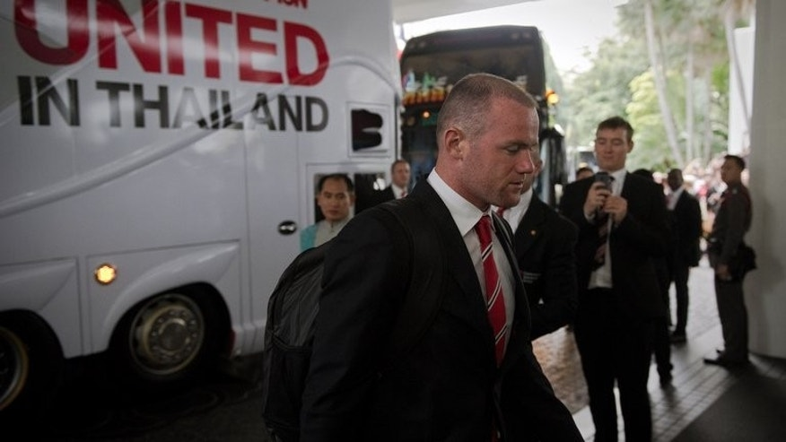 Manchester United striker Wayne Rooney arrives at a Bangkok hotel on July 11, 2013. Rooney will be out of action for a month after sustaining a hamstring injury during training in the Thai capital.