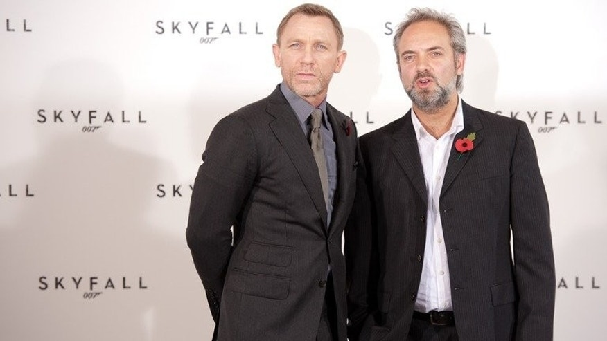 British actor Daniel Craig (L) poses with British director Sam Mendes in central London on November 3, 2011. The next James Bond film will be released in late 2015, producers announced Thursday, with Craig reprising his role as the suave British spy and Mendes returning as director after dramatically reversing his decision to quit.
