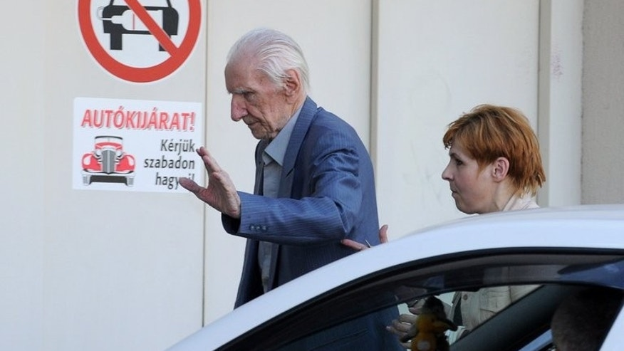 Laszlo Csatary, aka Ladislaus Csizsik-Csatary, arrives back to his home, where he is under house arrest, in Budapest on July 31, 2012, after his interrogation by the prosecutor office. A hearing in his case was postponed after he failed to appear.