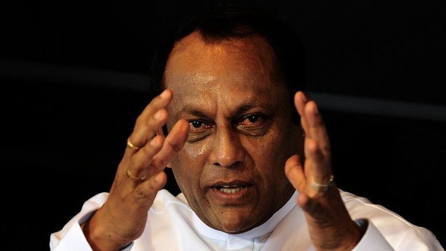 Sri Lanka's Investment Promotion Minister Lakshman Yapa Abeywardena speaks to reporters in Colombo on July 11, 2013. Sri Lanka's hotels are overcharging for rooms in an attempt to cash in on growing visitor numbers after a decades-long war, Abeywardena said.