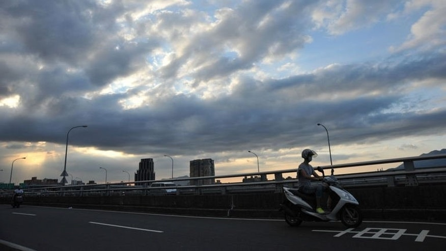Dark clouds gather above Taipei on July 10, 2013. Taiwan evacuated more than 2,000 tourists on Thursday as the island braced for super-typhoon Soulik with authorities warning of fierce winds and torrential rains.