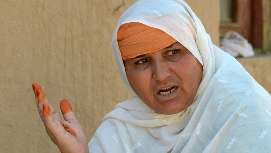Jan Bano, the mother of acid victim Tahira, gives an interview to AFP on June 20, 2013. In Pakistani villages and tribal communities it is still common for girls from poor families to be given to husbands at puberty.