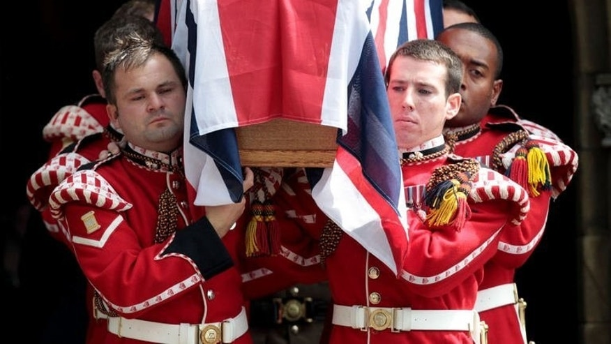 Royal Fusiliers carry the coffin of British soldier Lee Rigby out of Bury Parish Church in Greater Manchester, northwest England, following his funeral on July 12, 2013. British Prime Minister David Cameron joined thousands of mourners on Friday at the funeral of the soldier who was hacked to death on a London street in a suspected Islamist attack.