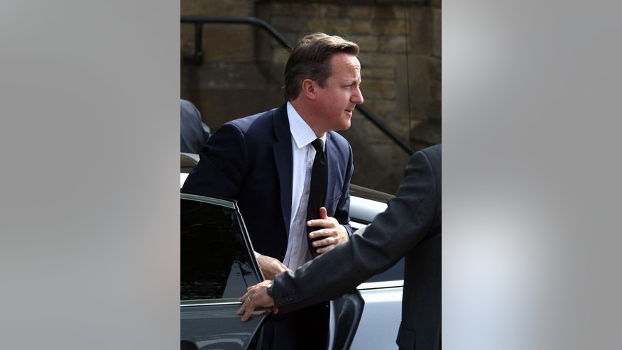 British Prime Minister David Cameron arrives at Bury Parish Church near Manchester, northwest England on July 12, 2013 for the funeral of murdered British soldier Lee Rigby. Cameron joined thousands of mourners on Friday at the funeral of the soldier who was hacked to death on a London street in a suspected Islamist attack.