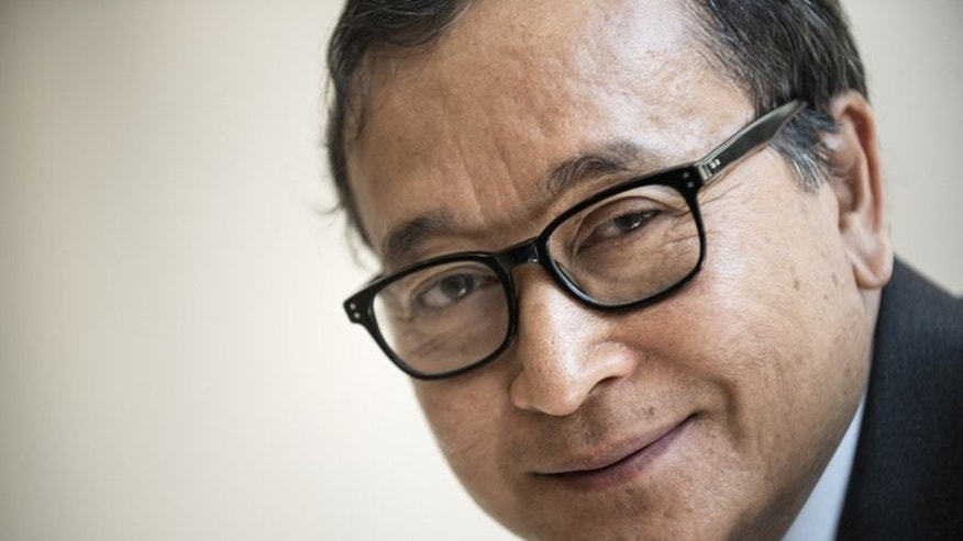 Cambodia's opposition leader Sam Rainsy poses for a portrait on May 9, 2013 during a visit to Washington DC. Rainsy has been pardoned by the king, according to a royal decree seen by AFP, clearing the way for his return ahead of national elections.