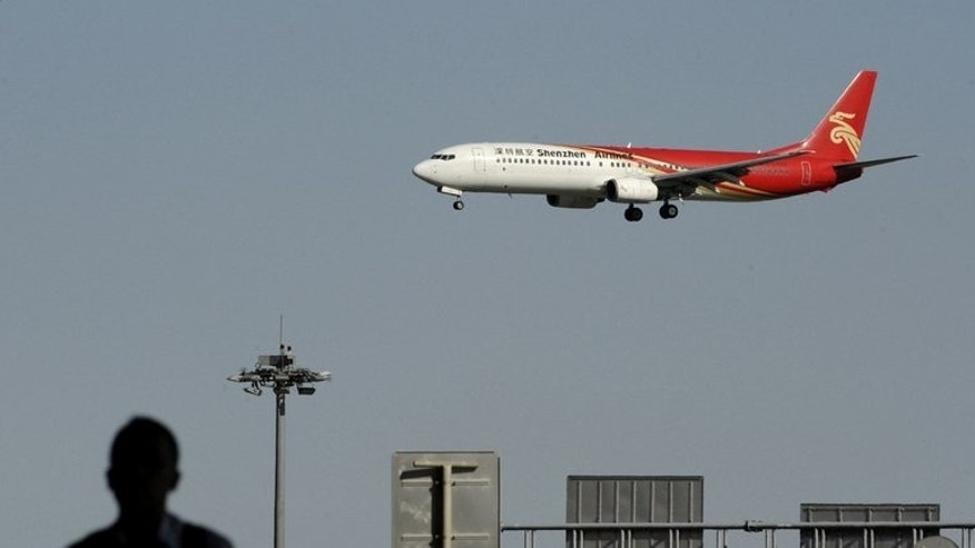 A Shenzhen airlines plane prepares to land at Beijing Capital International airport on September 4,2012. Air passengers in China experience the world's most disrupted travel plans, according to a report which names two of the country's major airports and its leading airlines among the most delayed.