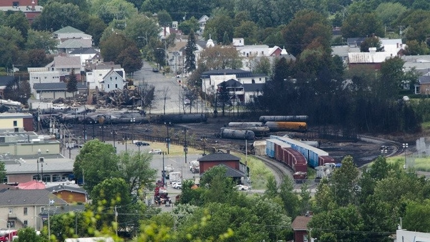 Scorched oil tankers remain on July 10, 2013 at the train derailment site in Lac-Megantic, Quebec. The death toll from the disaster rose to 28 after four more bodies were pulled from rubble of the devastated Canadian town.