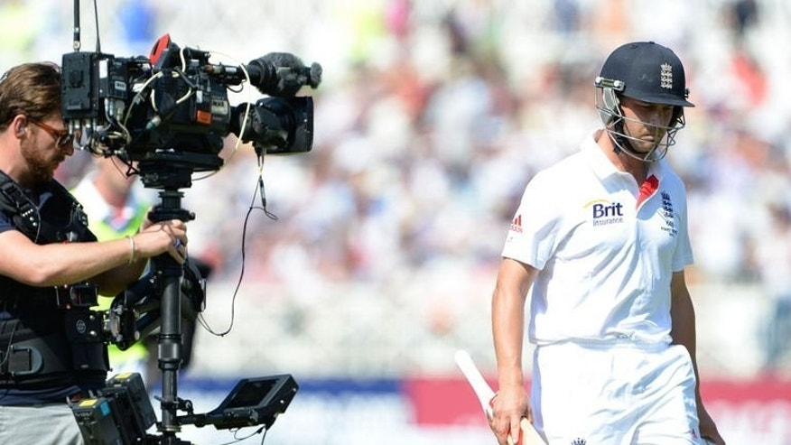 England batsman Jonathan Trott leaves the field after being given out by the third umpire on the second day of the first Ashes Test match against Australia at Trent Bridge in Nottingham on July 11, 2013. The inventor of the Hot Spot thermal imaging replay system has apologised to England for the manner in which Trott was given out by the third umpire.