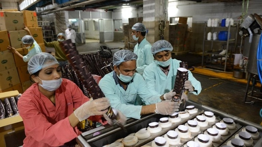 Workers stack ice cream cones at a factory in Pundhara near Ahmedabad in May. India's industrial output shrank by a shock 1.6 percent in May from a year ago, official data showed Friday, adding to mounting gloom for Asia's third-largest economy.