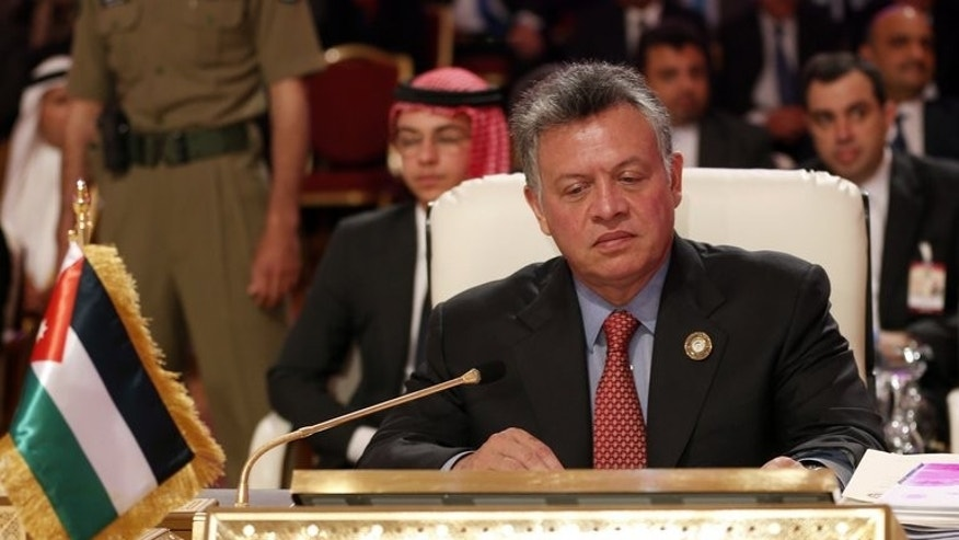 Jordan's King Abdullah II attends the opening of the Arab League summit in the Qatari capital Doha on March 26, 2013. Jordan breathed a sigh of relief when Egypt's Muslim Brotherhood president was ousted because of the influence of its own opposition Islamists who have pressed for reforms, analysts say.