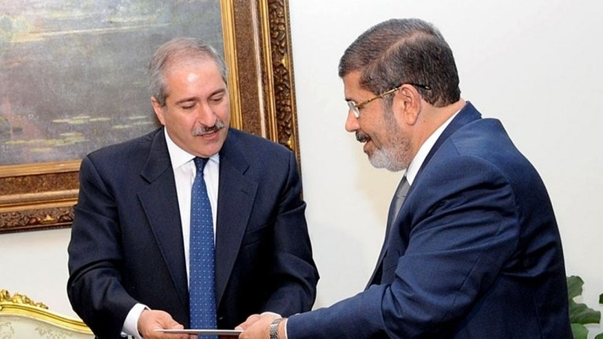 A handout photograph released by the Egyptian Presidency, shows President Mohamed Morsi (R) receiving a letter from Jordanian Foreign Minister Nasser Judeh in Cairo, on July 25, 2012. Jordan breathed a sigh of relief when Egypt's Muslim Brotherhood president was ousted because of the influence of its own opposition Islamists who have pressed for reforms, analysts say.