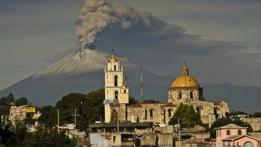 Ash spews from Mexico's Popocatepetl volcano, some 55 km from Mexico City, as seen from San Damian Texoloc in the Mexican central state of Tlaxcala, on July 9, 2013. A handful of US flights were canceled at two Mexican airports on Friday after ash from a nearby volcano fell in central Mexico, authorities said.