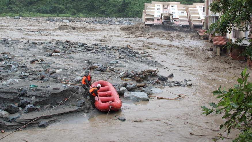 July 11, 2013 - Rescuers work to reach residents trapped by mudslides in Pengzhou near Chengdu in southwestern China's Sichuan province.