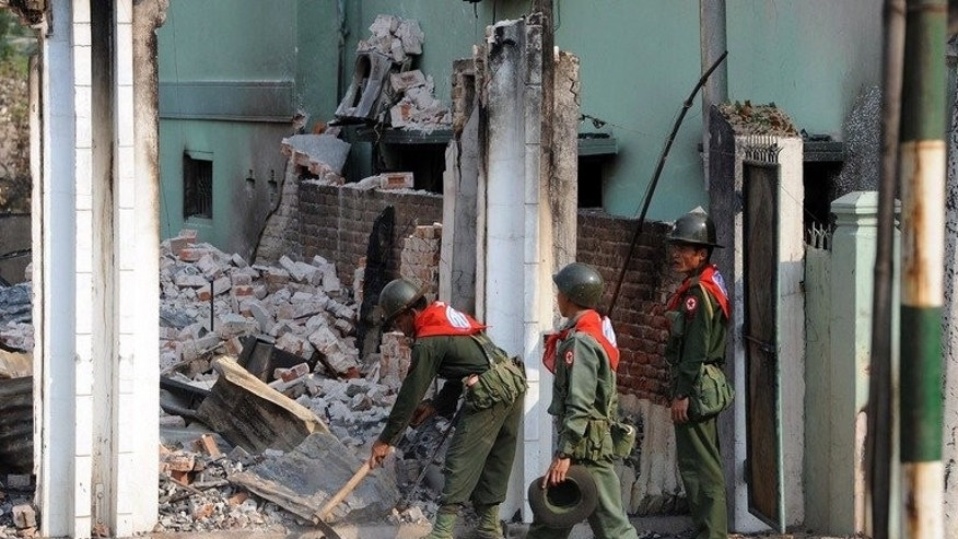 Soldiers take part in clean-up operations after an outbreak of communal violence in Meiktila, central Myanmar on March 24, 2013. Attacks against Muslims -- who make up an estimated four percent of Myanmar's population -- have exposed deep fractures in the Buddhist-majority nation and cast a shadow over its emergence from army rule.
