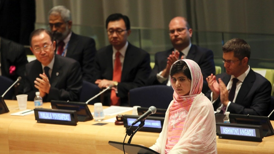 July 12, 2013 - United Nations Secretary-General Ban Ki-moon, left, applauds as Malala Yousafzai, right, addresses the Malala Day Youth Assembly at UN headquarters. Yousafzai, the Pakistani teenager shot by the Taliban for promoting education for girls, celebrated her 16th birthday Friday.