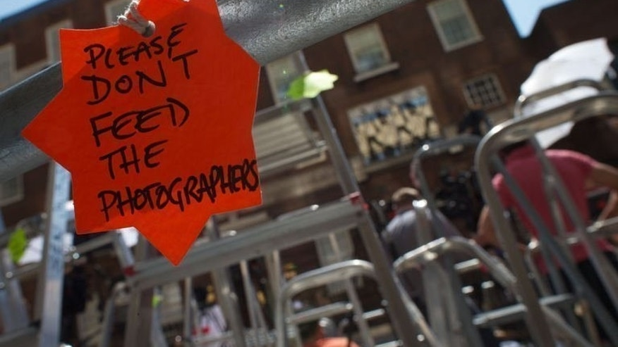A sign saying 'please don't feed the photographers' inside the media pen outside the entrance to the Lindo Wing of St Mary's Hospital in Paddington, west London on July 9, 2013. The world's media have been camped for days outside the London hospital where Prince William's wife Catherine will give birth, but the royal couple are expected to tightly control access to the new heir to the throne.