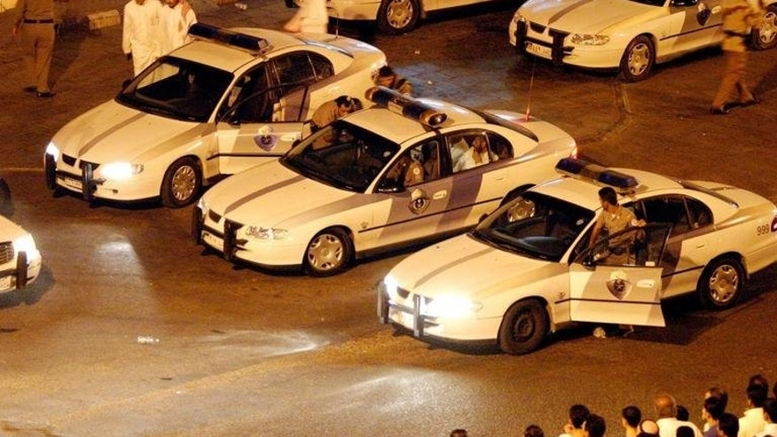 Saudi Arabian police make arrests on April 22, 2004 in Jeddah. A Saudi court has sentenced 11 people including foreigners to jail on charges including weapons training, bomb-making and ties to Al-Qaeda, the SPA state news agency reported Friday.