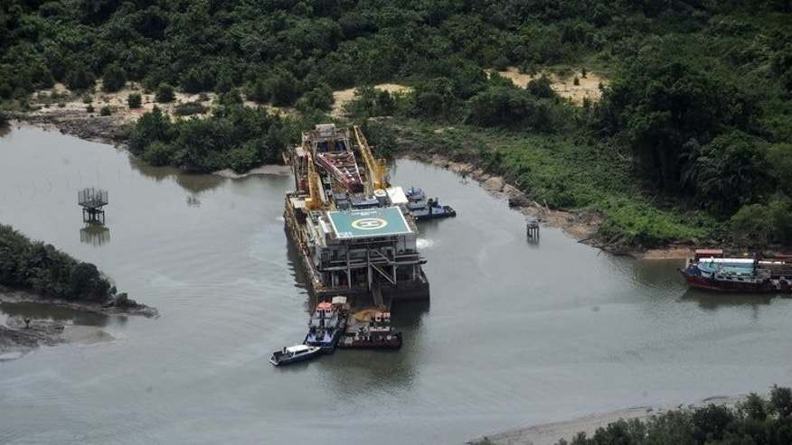 An aerial view of the Shell Awobo flow station in the Niger Delta taken on March 22, 2013. Shell has shut a major pipeline in Nigeria for the second time in less than a month after locating another leak on the line repeatedly hit by oil thieves, the company said on Friday.
