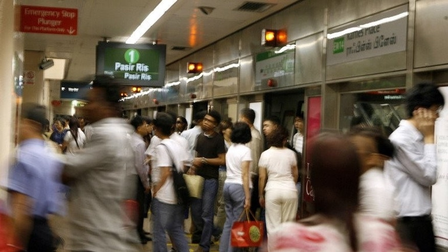 People get on and off a subway train at an MRT metro station in Singapore, February 15, 2007. Suicides in Singapore hit an all-time high of 487 in 2012 as more young people bogged down by stress and relationship woes took their own lives, a charity group dealing with the problem said Friday.