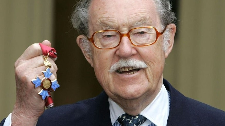 Presenter Alan Wicker poses with his CBE after receiving the honour at Buckingham Palace on March 22, 2005. The travel broadcaster, the consummate gentleman abroad during more than six decades on television, has died, aged 87.