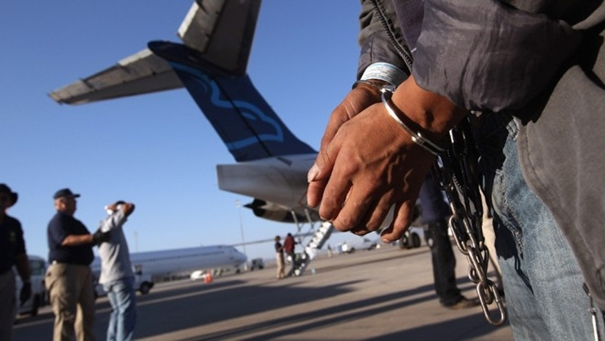 "MESA, AZ - JUNE 24:  An undocumented Guatemalan immigrant, chained for being charged as a criminal, prepares to board a deportation flight to Guatemala City, Guatemala at Phoenix-Mesa Gateway Airport on June 24, 2011 in Mesa, Arizona. The U.S. Immigration and Customs Enforcement agency, ICE, repatriates thousands of undocumented Guatemalans monthly, many of whom are caught in the controversial ""Secure Communities"" data-sharing program which puts local police on the frontlines of national immigration enforcement. ICE recently announced a set of adjustments to the federal program after many local communities and some states, including New York, insisted on opting out, saying immigrants were being deported for minor offenses such as traffic violations. Guatemala ranks only second to Mexico in the number of illegal immigrants deported from the United States.  (Photo by John Moore/Getty Images)"