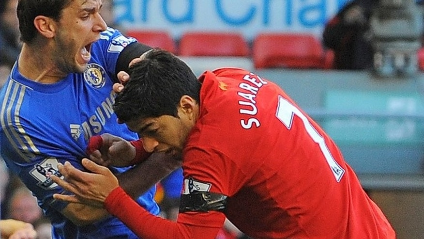 Luis Suarez (right) clashes with Branislav Ivanovic after biting the Chelsea defender at Anfield on April 21. Manager Arsene Wenger refused to be drawn Friday on whether Arsenal would match Liverpool's reported asking price for striker Luis Suarez, after a 30 million-pound bid was said to have been rejected.