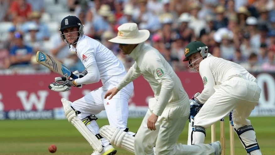 England's Stuart Broad (L) bats during the third day of their first Ashes Test match against Australia, at Trent Bridge in Nottingham, central England, on July 12, 2013. Australia were left fuming as Broad enjoyed a massive slice of luck as England tightened their grip on the opening Test.