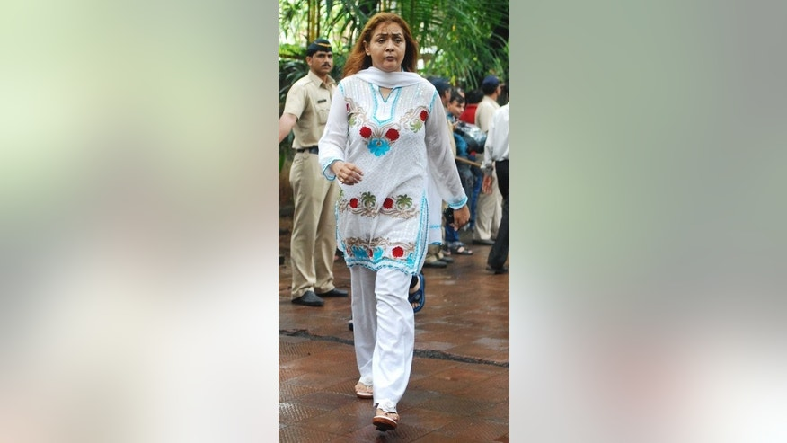 Bollywood actress Sahila Chadha arrive for the cremation of late actor Pran in Mumbai, on July 13, 2013. Veteran actor Pran -- who played villains and character roles in more than 400 movies -- has been cremated in Mumbai following his death at the age of 93.