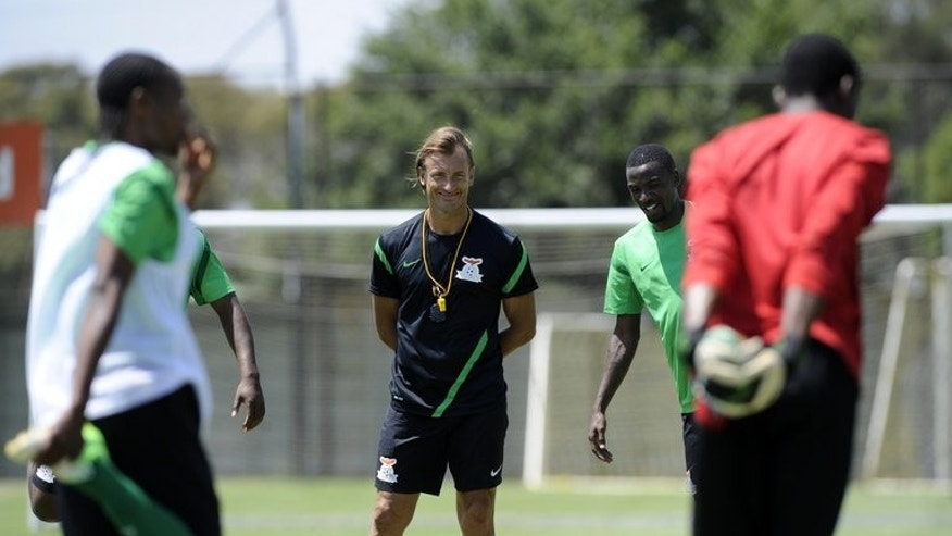 Zambia's coach Herve Renard (C) pictured with his players during a training session in Johannesburg, on January 10, 2013. Zambia embark on Sunday on a Cosafa Cup journey they hope will last seven days and finish with a record-equalling fourth title.