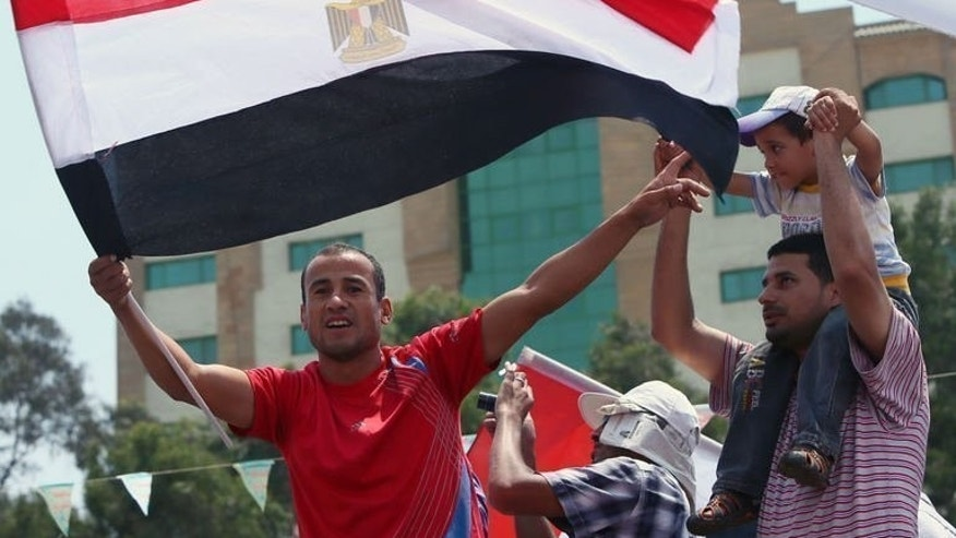 An Egyptian supporter of ousted president Mohamed Morsi waves a national flag during a rally in Cairo on July 12, 2013. Egypt's new prime minister planned further talks Sunday on forming a cabinet, as prosecutors looked at criminal complaints against Morsi and members of his Muslim Brotherhood