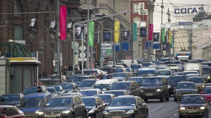 Cars are blocked in a traffic jam in the center of Moscow, on February 29, 2012. Russian police say at least 14 people have been killed and 16 injured in a traffic accident outside Moscow involving a truck, a passenger bus and several other vehicles.