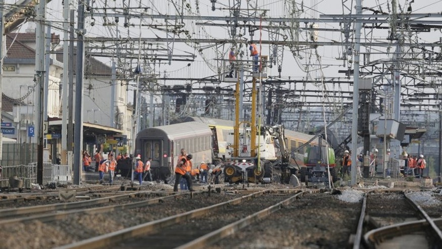 The site of a train accident is seen on July 13, 2013 at the railway station of Bretigny-sur-Orge, near Paris. Rail investigators said Saturday they had found a fault in the track where the train derailed near Paris, killing six people and injuring dozens more.