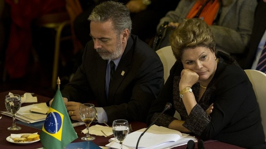 Brazil's President Dilma Rousseff (R) and Foreign Minister Antonio Patriota during the XLV Mercosur Summit in Montevideo on July 12, 2013. South American leaders defended their right to offer asylum, venting anger at claims of US spying in the region while intelligence leaker Edward Snowden's fate hangs in the balance.