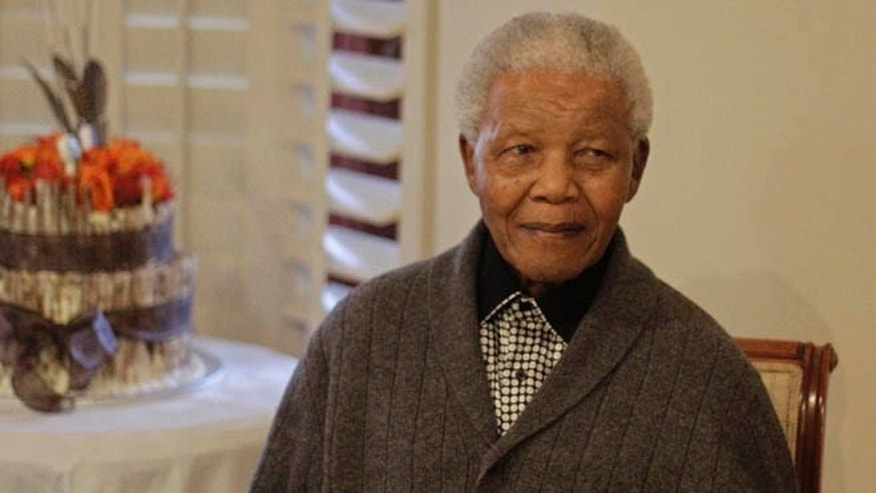 FILE: July 18, 2012: Former South African President Nelson Mandela as he celebrates his 94th birthday with family in Qunu, South Africa.