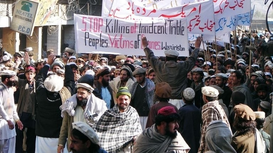 Pakistani tribesmen march in Miransha, Pakistan, during a protest rally against US drone attacks on January 21, 2011. A US drone strike in the troubled northwestern tribal belt of North Waziristan late Saturday killed two militants on a motorcycle and damaged nearby houses, officials said.