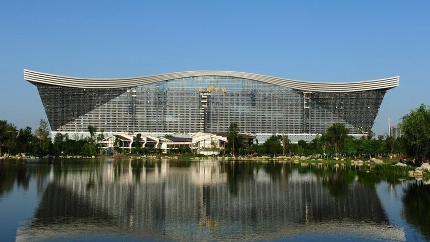 "This picture taken on May 26, 2013 shows the ""New Century Global Centre"" building in Chengdu, in southwest China's Sichuan province. Boasting its own artificial sun and a floor area three times that of the Pentagon, the ""world's largest building"" has opened in southwest China to mixed reviews from its first visitors."