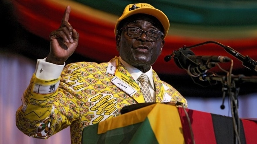 "Zimbabwean President Robert Mugabe speaks in Gweru on December 7, 2012. Mugabe accused his political rivals Saturday of wanting to bring back ""white people"" and took a swipe at gay rights as campaigning gears up ahead of the July 31 election."