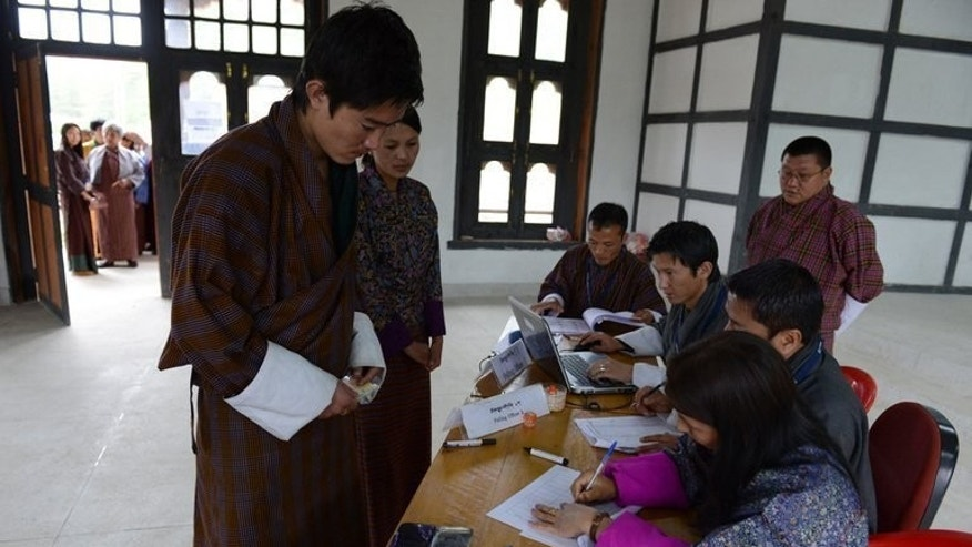 "Bhutanese voters register before casting their vote at a polling station in Paro, on May 31, 2013. Bhutan's opposition party has swept to power in the Himalayan kingdom's second-ever election due to voter concerns about the economy and the country's famed ""Gross National Happiness"" index, analysts said."