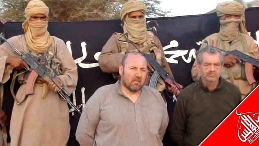 An undated handout image released by Al-Andalus, the media branch of Al-Qaeda in the Magreb (AQIM) to the Agence Nouakchott Informations (ANI) on December 9, 2011 shows French nationals Philippe Verdon (R) and Serge Lazarevic being held by AQIM at an undisclosed location. The body of Verdon, who was announced killed by his Al-Qaeda captors in March appears to have been found in Mali.