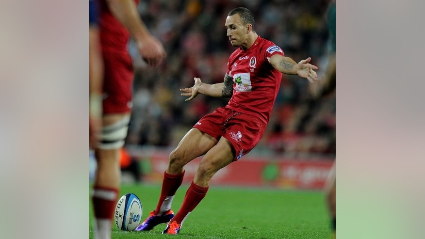 This file photo shows Quade Cooper of the Queensland Reds kicking a field goal during a Super 15 rugby union match in Brisbane, on July 2, 2011. The Reds clung on for a 14-12 win over the New South Wales Waratahs on Saturday to finish fifth in the final season standings, ahead of the Cheetahs.
