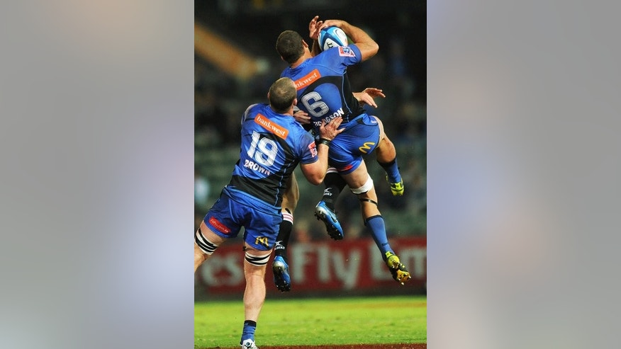 In this file photo, Matt Hodgson (R), with teammate Richard Brown, from the Western Force marks the ball from a restart during a Super 15 rugby union match in Perth, on May 26, 2012.