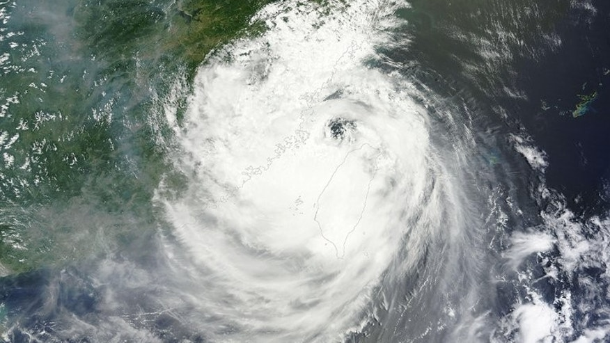 This NASA satellite image shows Typhoon Soulik, on July 13, 2013. Soulik was set to dump up to 18 centimetres (seven inches) of rain on eastern parts of China in just 24 hours, forecasters said on Sunday, a day after the storm killed two when it battered Taiwan.