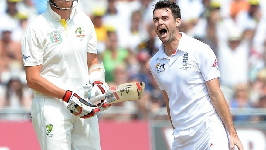 "England's James Anderson (R) celebrates claiming the wicket of Australia's Peter Siddle on July 14, 2013. Defiant Australia captain Michael Clarke insisted the tourists were ""here to compete"" after taking England to the wire before losing the first Ashes Test at Trent Bridge by just 14 runs."