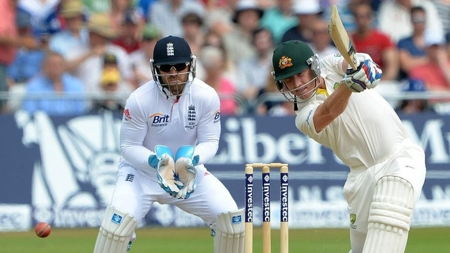 England's Matt Prior (L) watches Australia's Brad Haddin bat during the fifth day of the first Ashes Test on July 14, 2013. A last-wicket partnership of 65 between Haddin (71) and James Pattinson (25 not out) almost produced one more twist in a thrilling Test full of fluctuating fortunes.