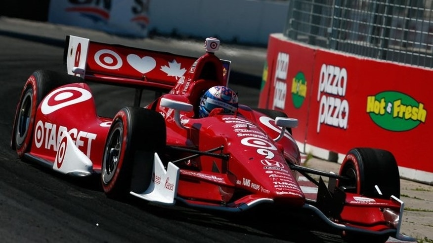 Scott Dixon of New Zealand drives the Target Chip Ganassi Racing Honda during the IZOD INDYCAR Series Honda Indy Toronto Race 1 on July 13, 2013 in Toronto, Canada. Dixon held off Sebastien Bourdais to capture the first race of the weekend doubleheader in Toronto.