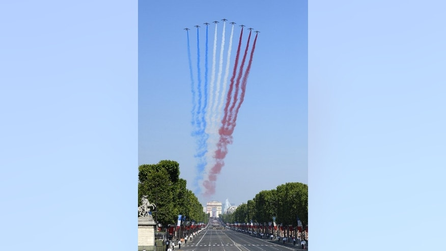"French jets from the Air Force Patrouille de France release trails of red, white and blue smoke as they fly over the Place de la Concorde during the Bastille Day parade in Paris, on July 14, 2013. French President Francois Hollande has vowed to fight France's deep-rooted ""pessimism"" in the face of a struggling economy."
