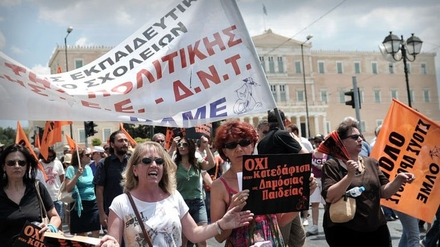 Teachers protest in front of the Greek Parliament on July 11, 2013 in Athens. Debt-wracked Greece has had to enact a string of austerity measures over the past four years in return for multi-billion euro international bailouts to avoid default.